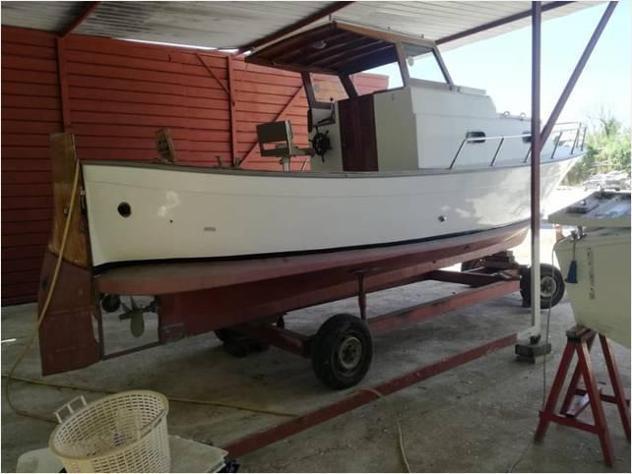 Barca a motore gozzo 7 cabinato td anno1990 lunghezza mt7