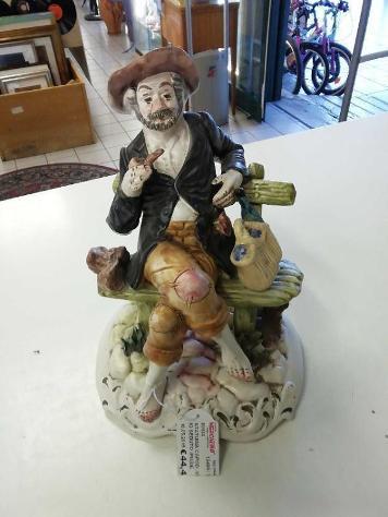 Statuina capod. vecchio seduto (piede sbeccato)