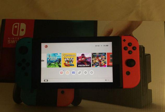 Nintendo switch con custodia e giochi