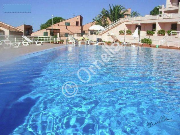 Bivani arredato climatizzato in residence con piscina