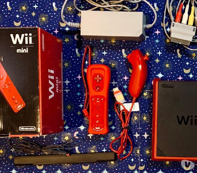 Nintendo wii mini rosso con remote plus e nunchuk 2 giochi