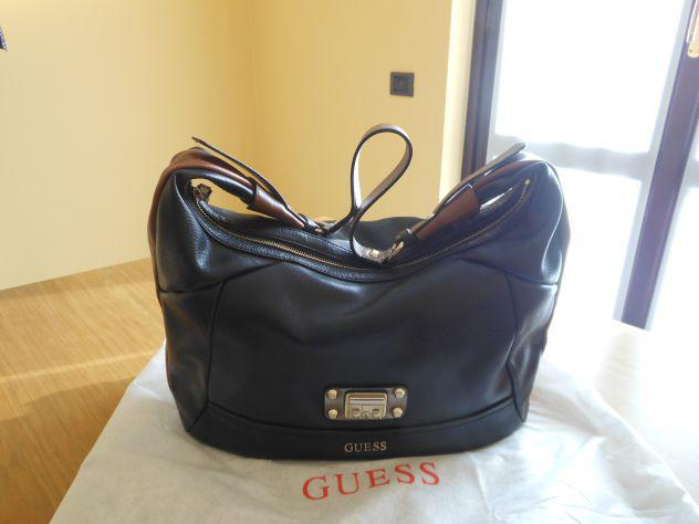 Vendo borsa vintage #guess nera con chiusura con bottone e