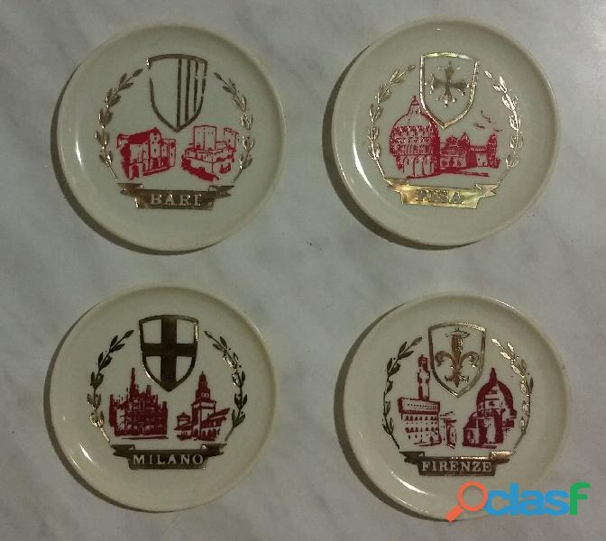 4 vecchi sottobichieri in plastica bianca con gli stemmi delle citta' milano, bari, pisa, firenze