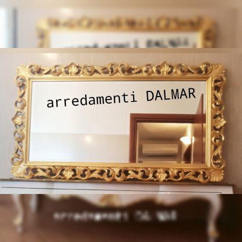 Specchio barocco in foglia oro.