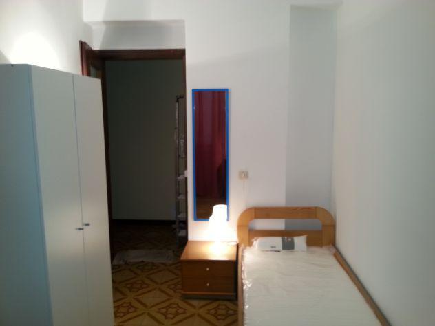 Camera singola in appartamento con coinquilini