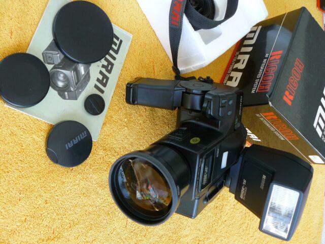 Ricoh mirai + tele + flash =nuovi in imballo e box originali
