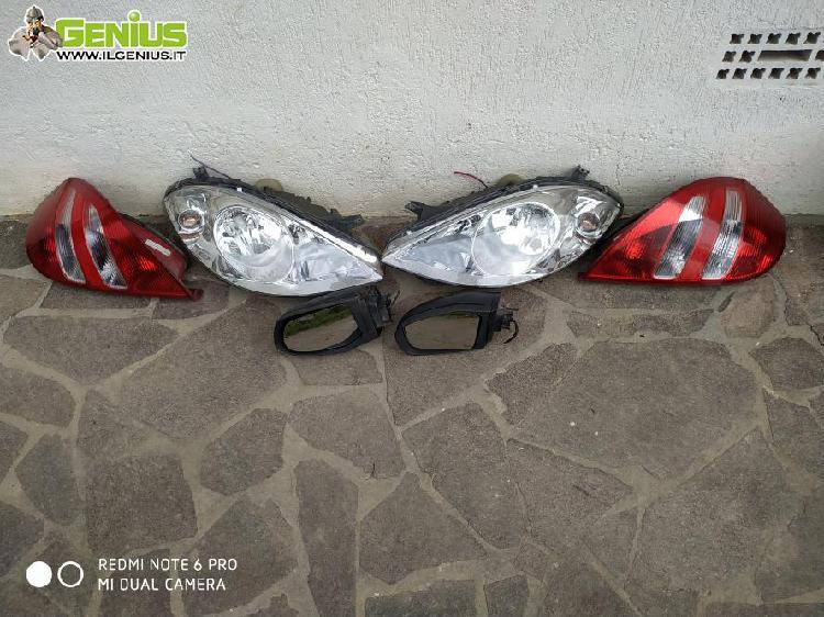 Fanali anteriori e posteriori + specchietti retrovisori