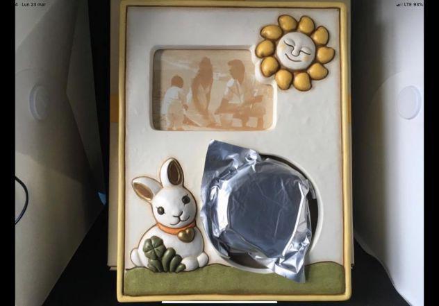 Thun - portafoto per bambini, neonato con calco manina